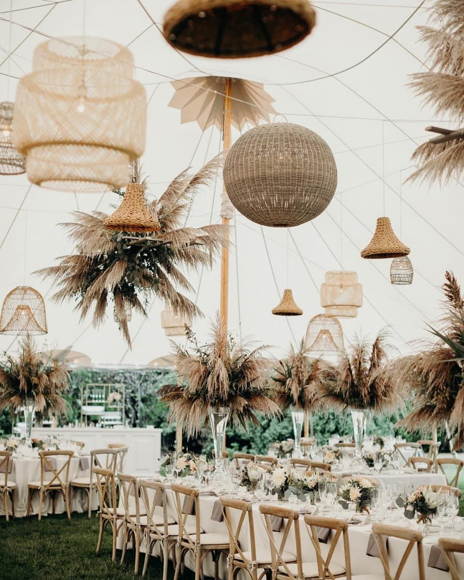 "Wedding Inspiration | Amanda on Instagram: ""A marquee wedding reception with mixed bohemian chandeliers and dried foliage towers? We're at a loss for words"