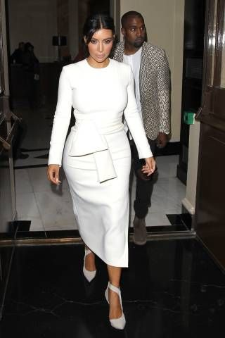 Kim Kardashian and Kanye West leave their hotel in London on Sept. 23, 2014.