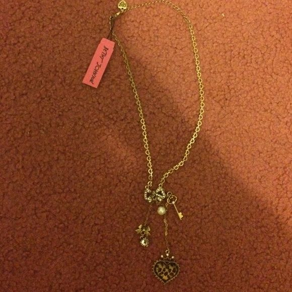 Betsey Johnson cheetah heart necklace. New w/tags Betsey Johnson cheetah heart with diamond bow necklace. Never worn. New with tags. Betsey Johnson Jewelry Necklaces