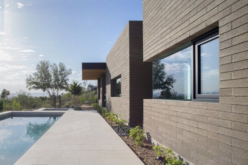 Modern Home Exterior Design With Concrete Brick Wall And Flat Roof
