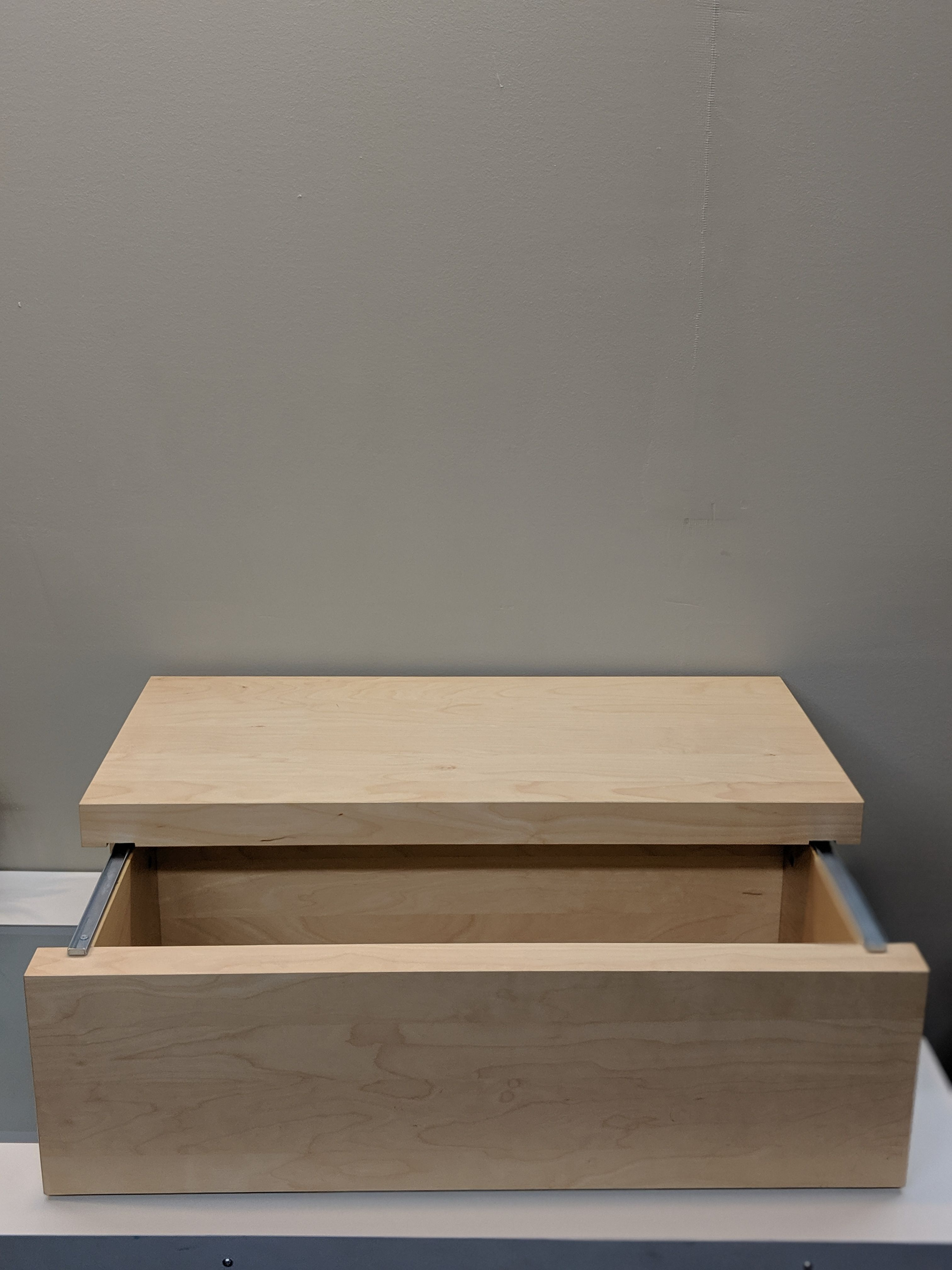 Storage rectangle with sliding top from Ikea. Part of the
