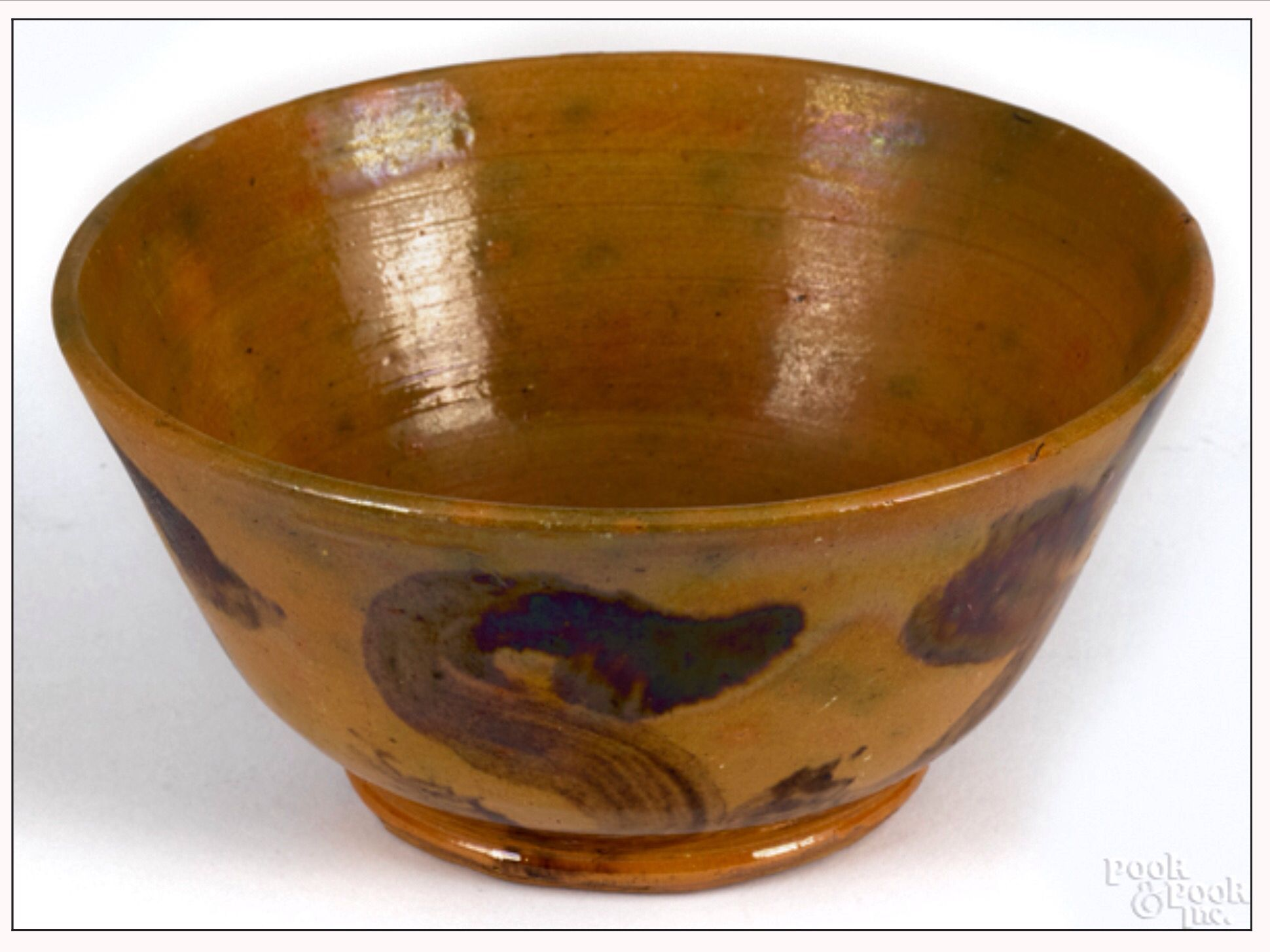 """Pook & Pook.  January 17th 2015. Lot 285.  Estimated: $1000 - $1500. Realized Price: $3600. Adams County, Pennsylvania redware bowl, inscribed Sol Miller 1872, having repeating manganese """"S"""" decoration around body, 2 3/4"""" h., 5 5/8"""" dia."""
