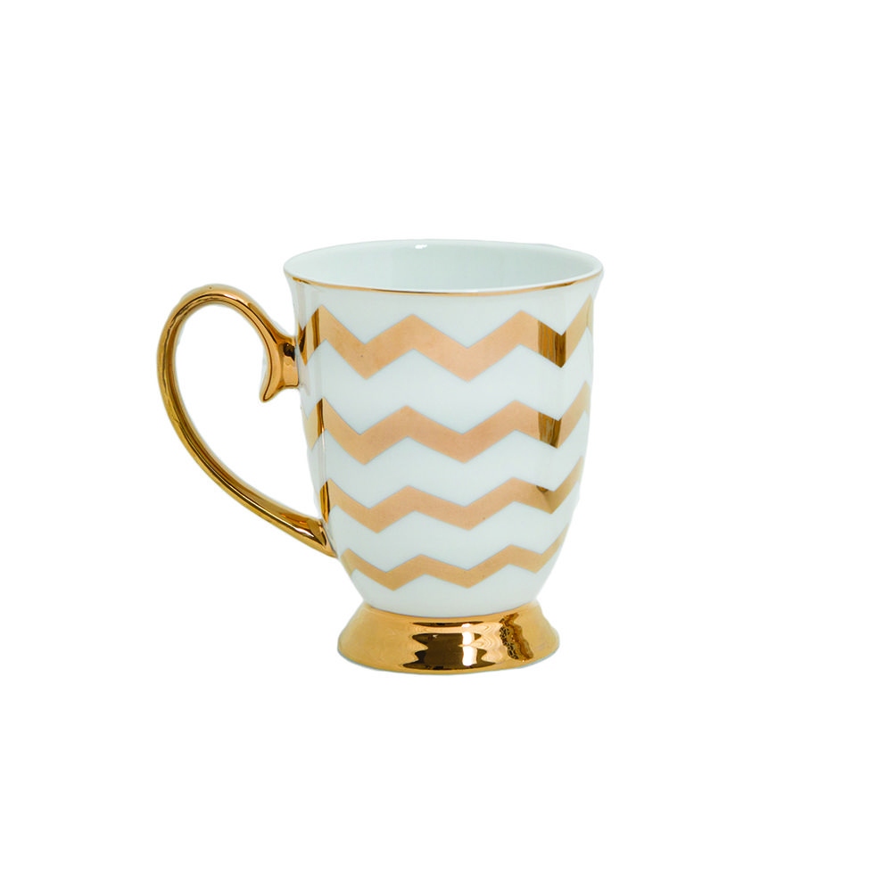 Celeste Gold Chevron Mug Experience High Tea in style with this Designer Tea Ware from Cristina Re. This beautiful metallic collection, 'High Society', is inspired by a bygone era of elegance, sophistication and glamour #tea #teaware #Mug #highsociety #homeware #decor #highteacollection #glamour #style #fashion #CristinaRe #CristinaReDesign