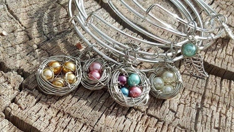 Delicately hold the ones who mean to the most to you close to your heart.This bangle is handcrafted featuring your choice of 1, 2, 3, 4 or 5 shimmering beads wire wrapped tightly into a nest. #KraftyChix #Bracelet