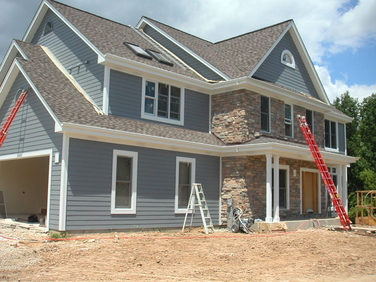 Chic hardie plank siding in gray matched with white trim for Homes with wood siding