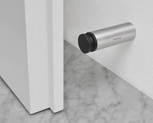 The Blomus Wall Mounted Door Stop Is Designed To Be Placed Behind Handle Elegantly Prevents A From Striking