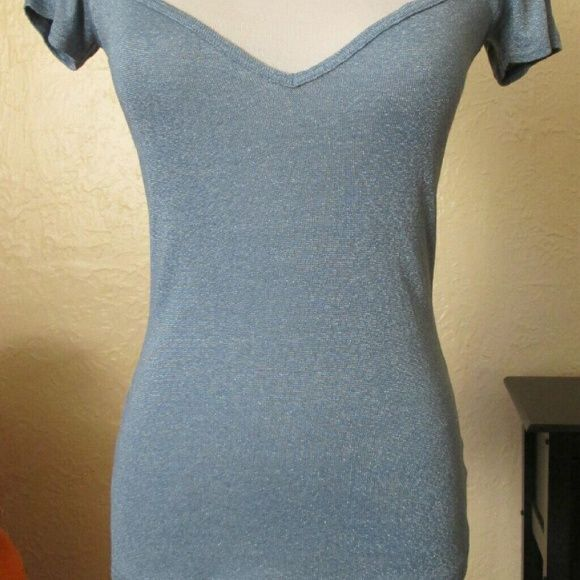 Lovely Michael Stars Top with Killer Neckline Pale blue cap sleeve top by Michael Stars. Has a nice shimmer to it. Gorgeous sweetheart neckline. One Size Fits Most; probably best for sizes 4 through 8. For reference, my dressform is a size 6. EUC, no flaws. Michael Stars Tops Tees - Short Sleeve