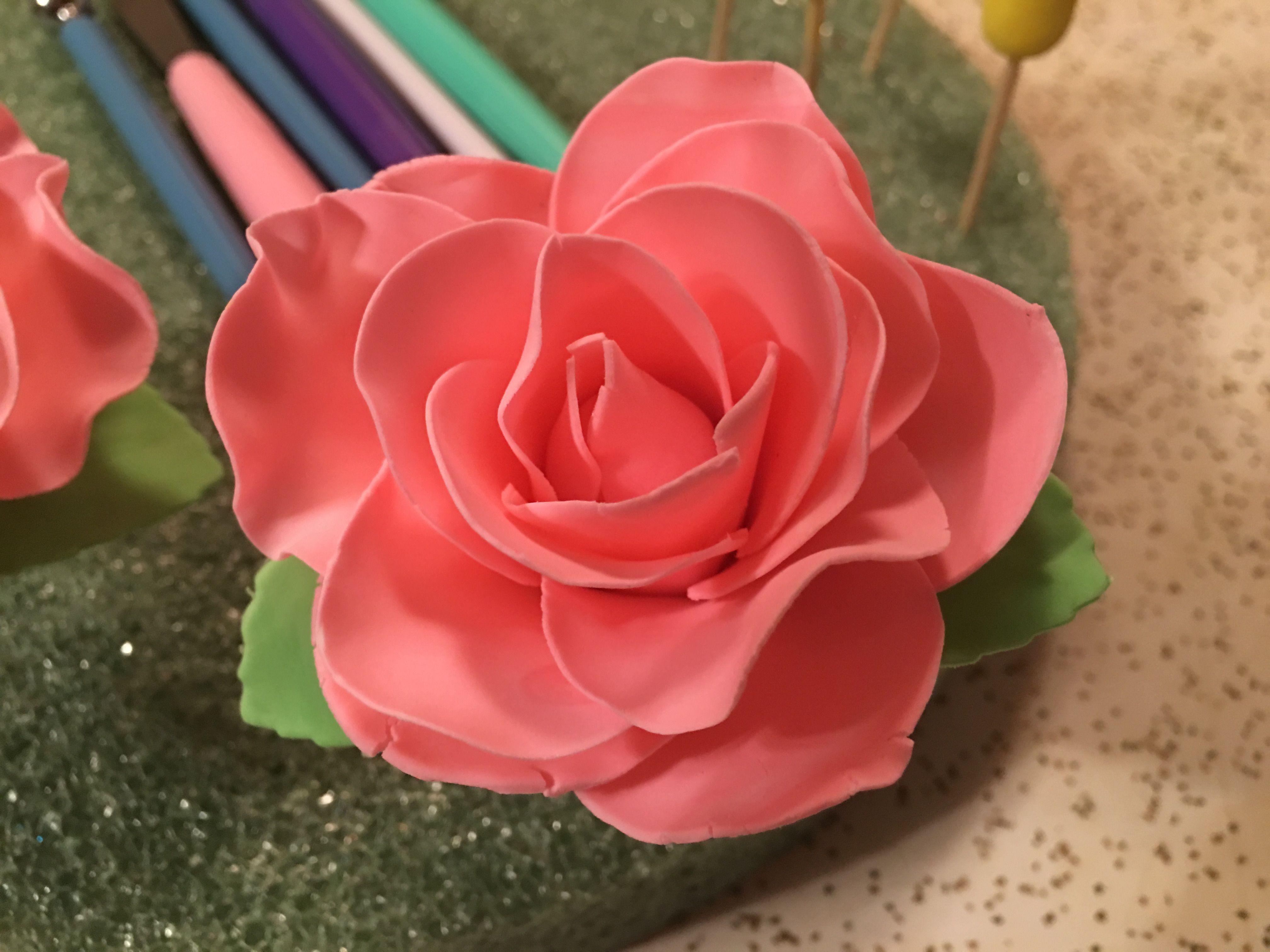 Pink rose made with the Wilton flower cutter. The gum paste was ...