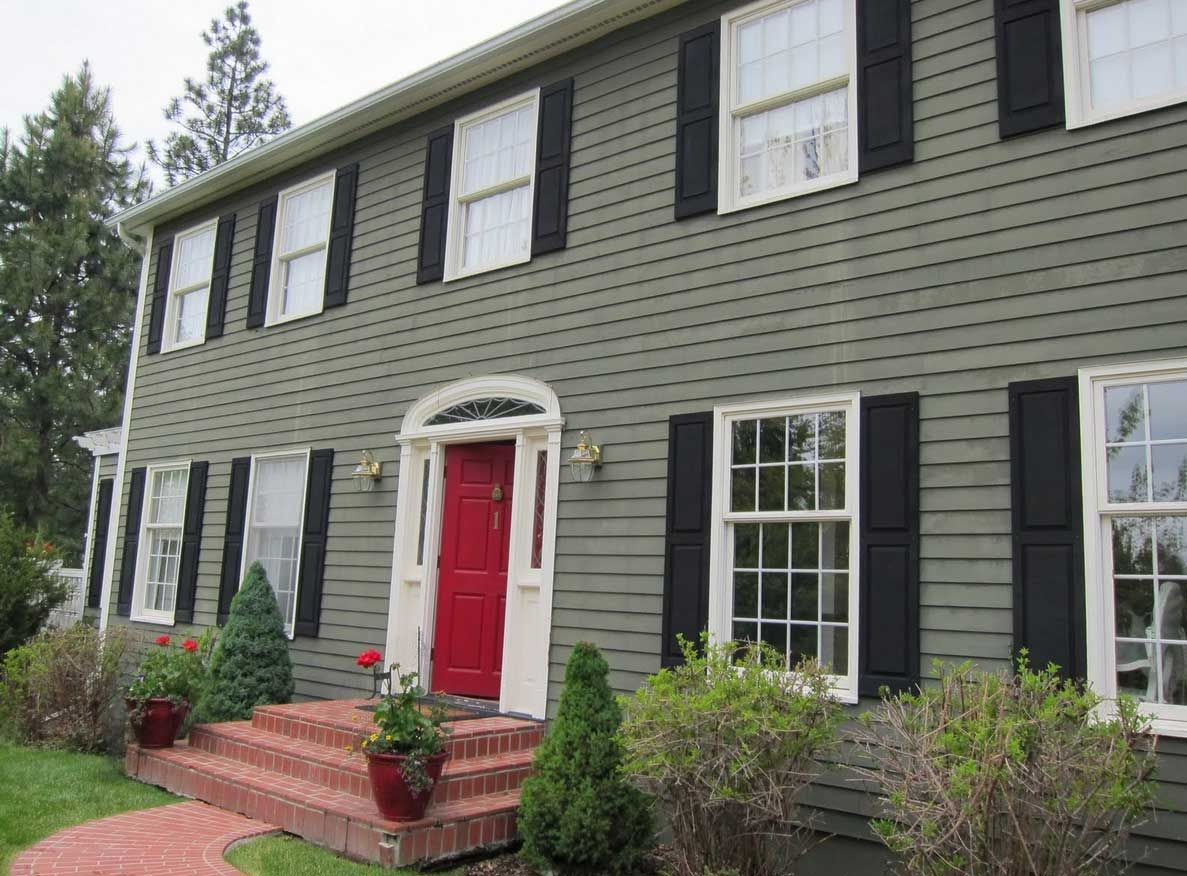 How To Paint Your House With Green Wall Color Theme Combine White Windows Frame And Red Main Door