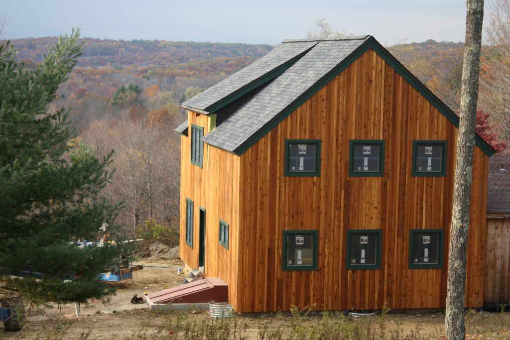 Barn wood siding vs board and batten modern rustic cabin for Homes with wood siding
