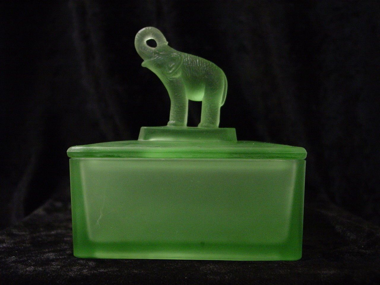 """Green Satin Glass Covered Dish with """"Trunk Up"""" Elephant -  3 2/4"""" x 2 1/2"""" stands almost 4 1/2"""" tall"""