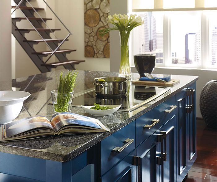Dark Wood Cabinets With A Blue Kitchen Island By Dynasty Cabinetry