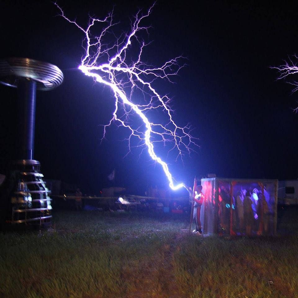 25 tall tesla coil musically discharging on a large faraday cage