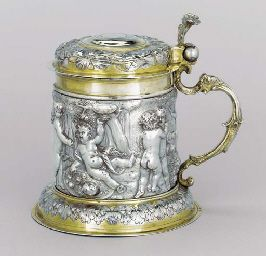 A German parcel-gilt tankard Halle, circa 1680, maker's mark RR Cylindrical, on domed foot chased with a band of foliage, the body deeply repoussé and chased with cherubs with animals and flowers in a woodland landscape, one holding aloft a tazza, the slightly domed cover chased with a border of flowers, with volute floral thumbpiece and double scroll handle, marked on cover, foot-rim, and base