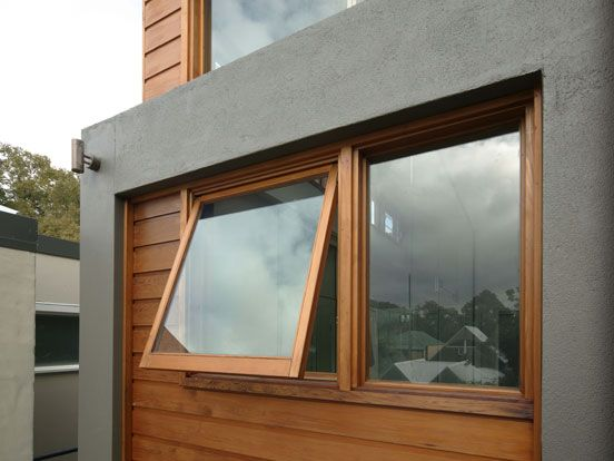 A wood exterior finish on these modern awning windows compliments the wall cladding and provides ventilation to the space.