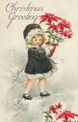 Little girl with poinsettias