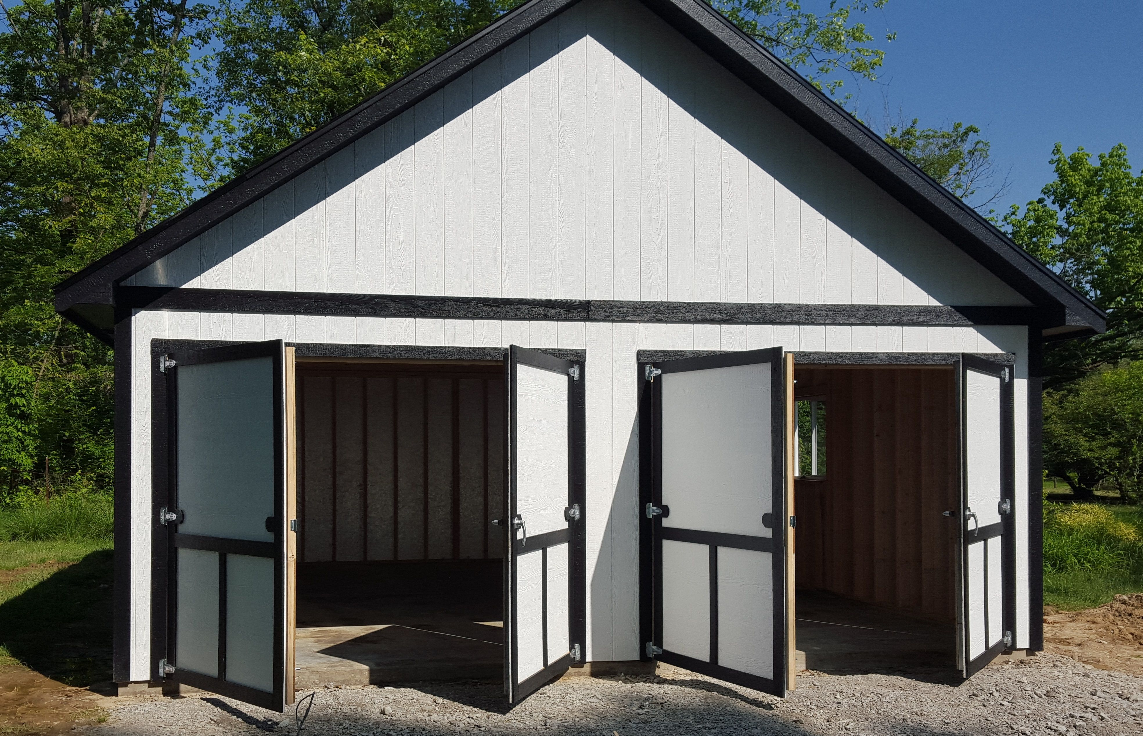 Custom double doors and a raised roof pitch for this