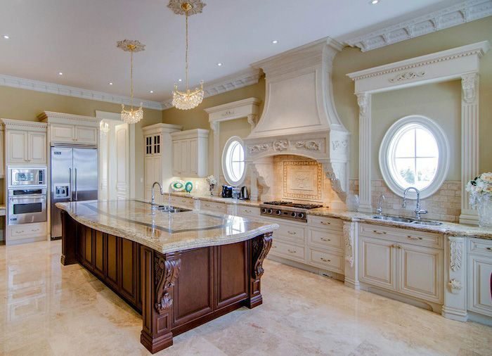 Wonderful Kitchen Design With White Kitchen Cabinets And Cherry Wood Kitchen Island  With Corbels And Carvings.