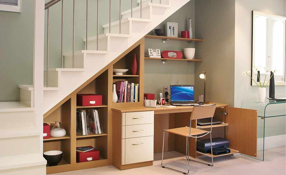 A Desk With Shelving Under The Stairs In This Home Is An Ideal Home Office Solution For Those Strap Office Under Stairs Small Space Staircase Desk Under Stairs