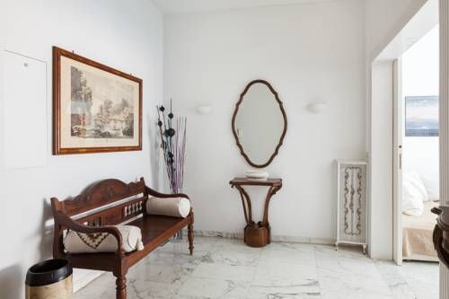 Baldo Apartment Roma Situated in Rome, this air-conditioned apartment features a terrace. The apartment is 1.6 km from St. Peter's Basilica. Free WiFi is featured throughout the property.  A dishwasher, an oven and a toaster can be found in the kitchen.