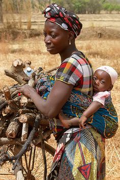 Babywearing photo: A mother & her child gathering wood, Banfora, Burkina Faso.