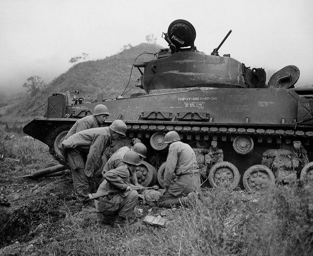 A Demolition Squad Of Company 65th Engineer Battalion 25th Infantry Division Place Dynamite Under The Tracks Burned Out Tank