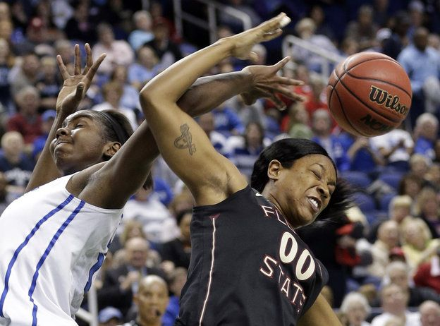 Florida State's Chasity Clayton, right, and Duke's Elizabeth Williams try for a rebound during the second half of an NCAA college basketball game at the Atlantic Coast Conference women's tournament in Greensboro, N.C., Saturday, March 9, 2013. Duke won 72-66. (AP Photo/Chuck Burton)    Read more here: http://www.charlotteobserver.com/2013/03/09/3904671/the-daily-edit-031013.html?spill=1#storylink=cpy