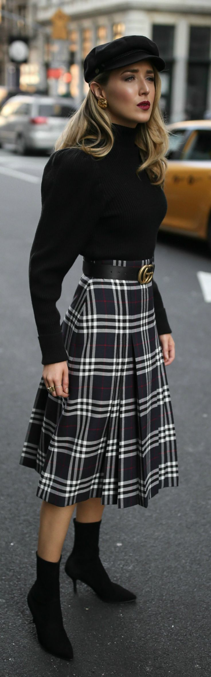 Pleated plaid midi skirt black puffedshoulder turtleneck black