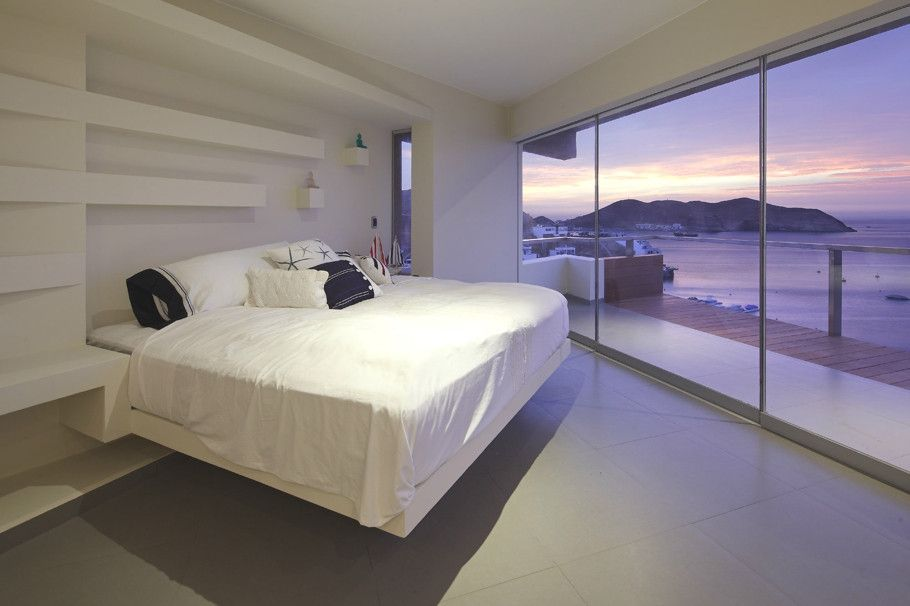 Minimalist bedroom with a gorgeous ocean view.