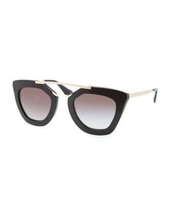 e78cacf1b278a Prada sunglasses. Thick, cat-eye acetate frames. Golden metal arms with  logo and enamel ear pieces. Solid lenses. Double nose bridge.