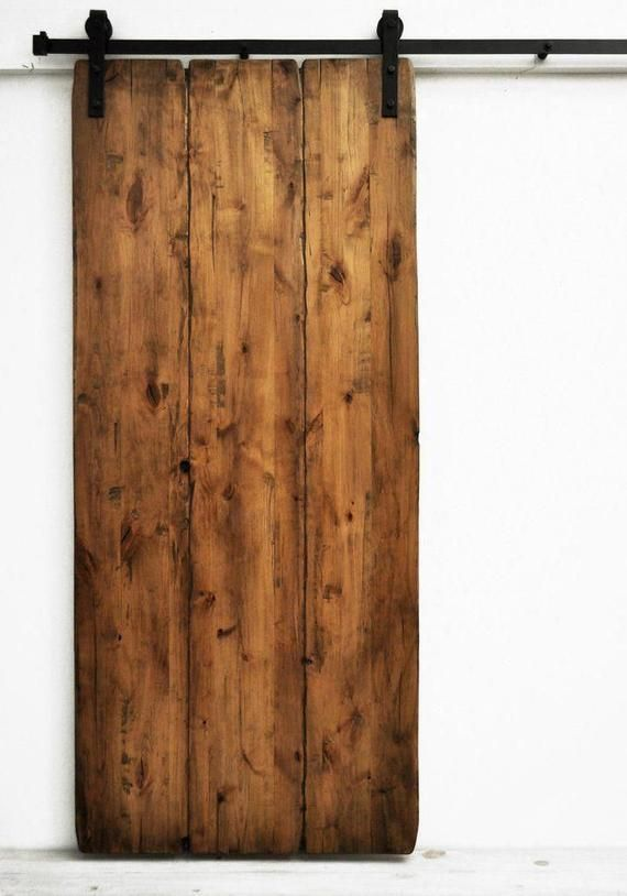 Sliding door exterior wall in solid aged wood with track