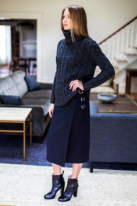 Emerson Fry (Fall 2014) chunky cable knit sweater and navy wool wrap skirt with buckle detail.