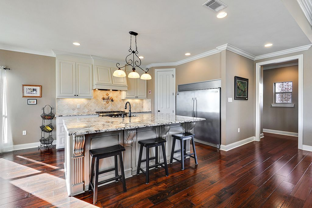 Traditional Kitchen With L Shaped Crown Molding Tibetan Barstool