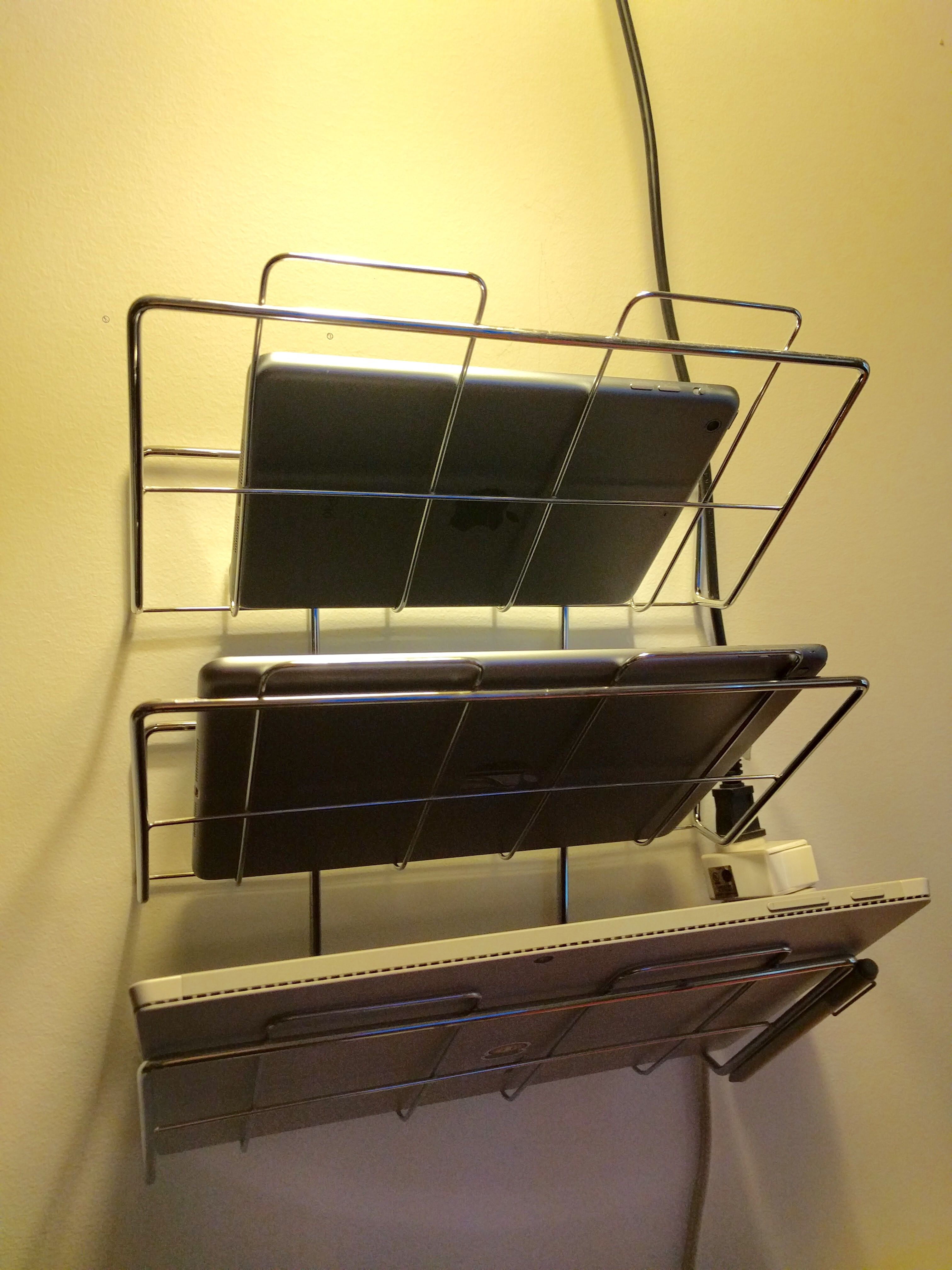 Tablet storage! Use a wall mounted file organizer to store your ...