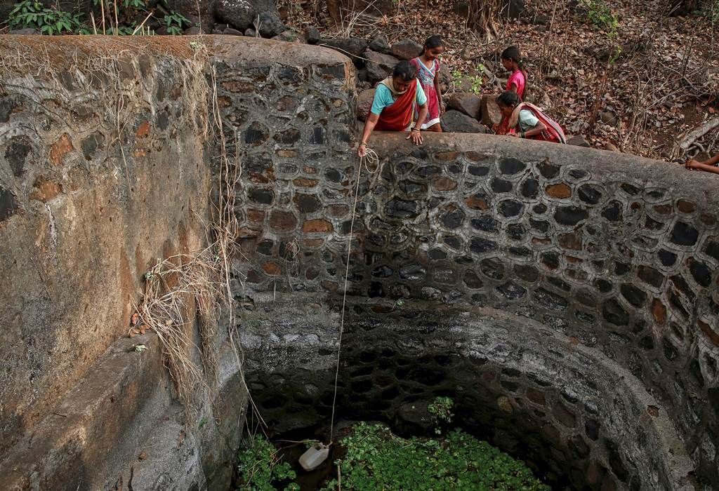 WOMEN COLLECT WATER AT WELL Indian Men Take on 'Water Wives' to Survive Drought - NBC News