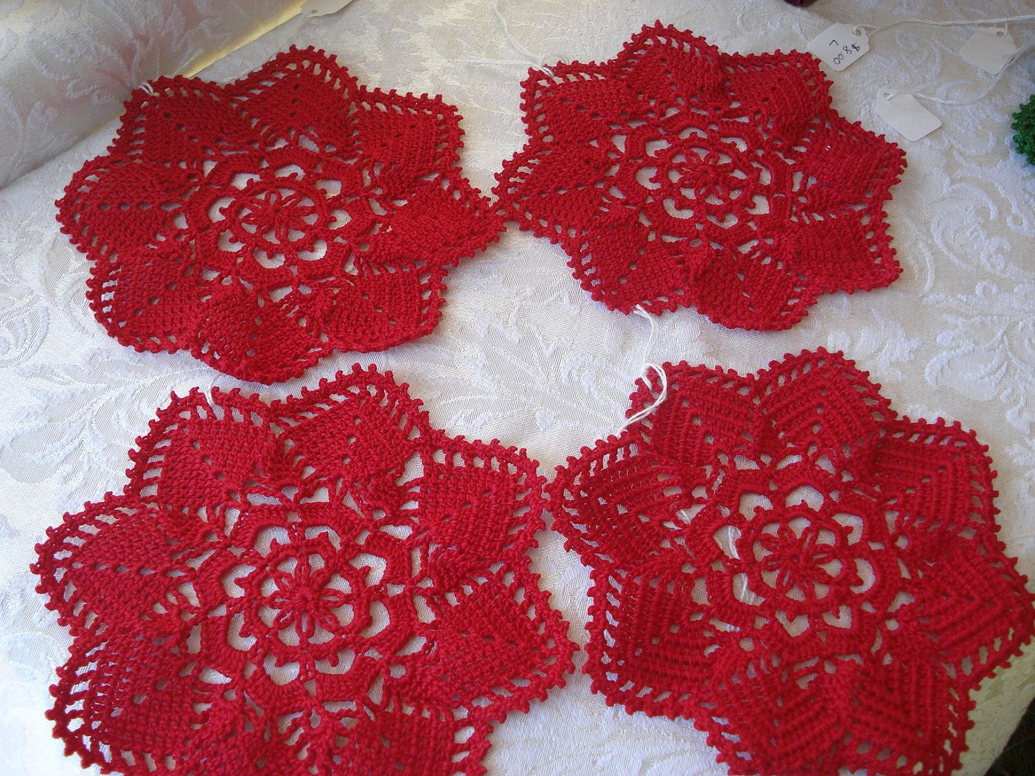 Crochet coasters in red or green by Doublemuse on Etsy, $8.00