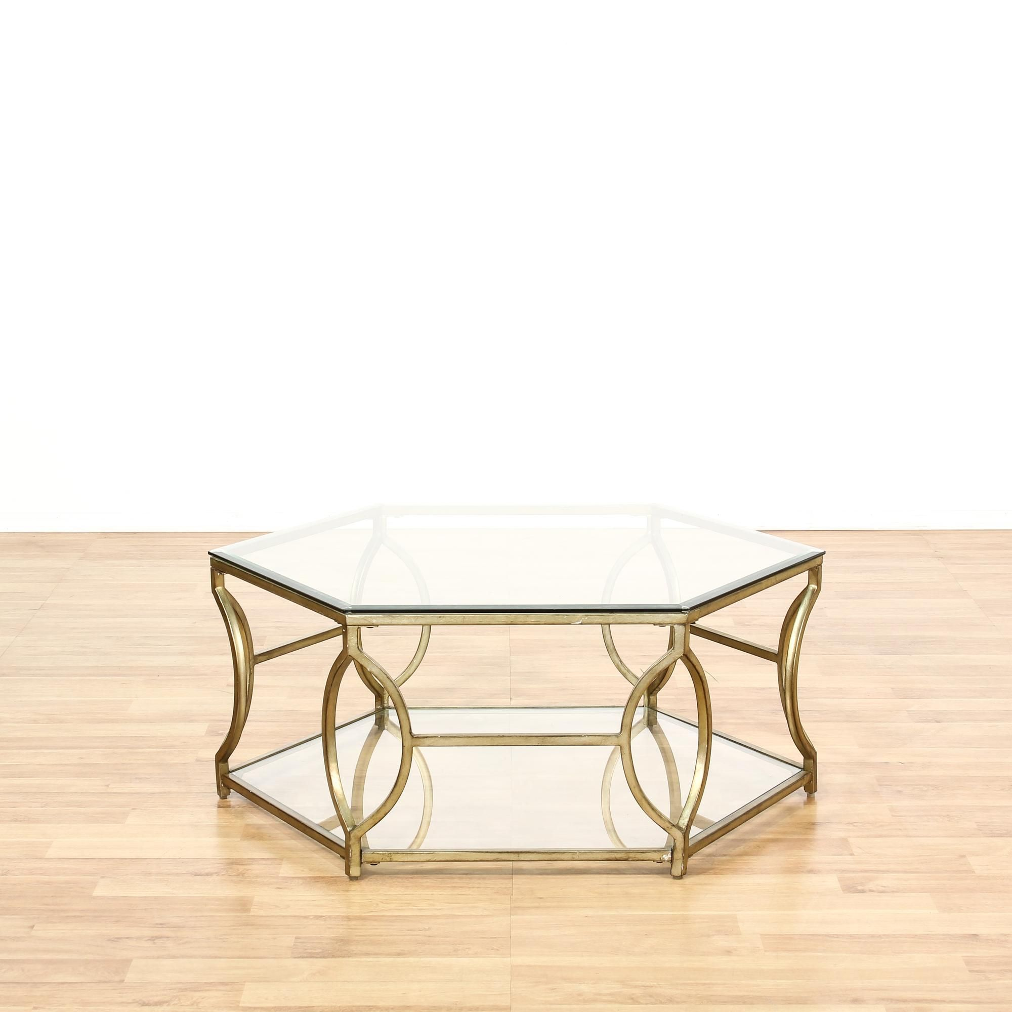 This octagon coffee table is featured in a shiny polished brass