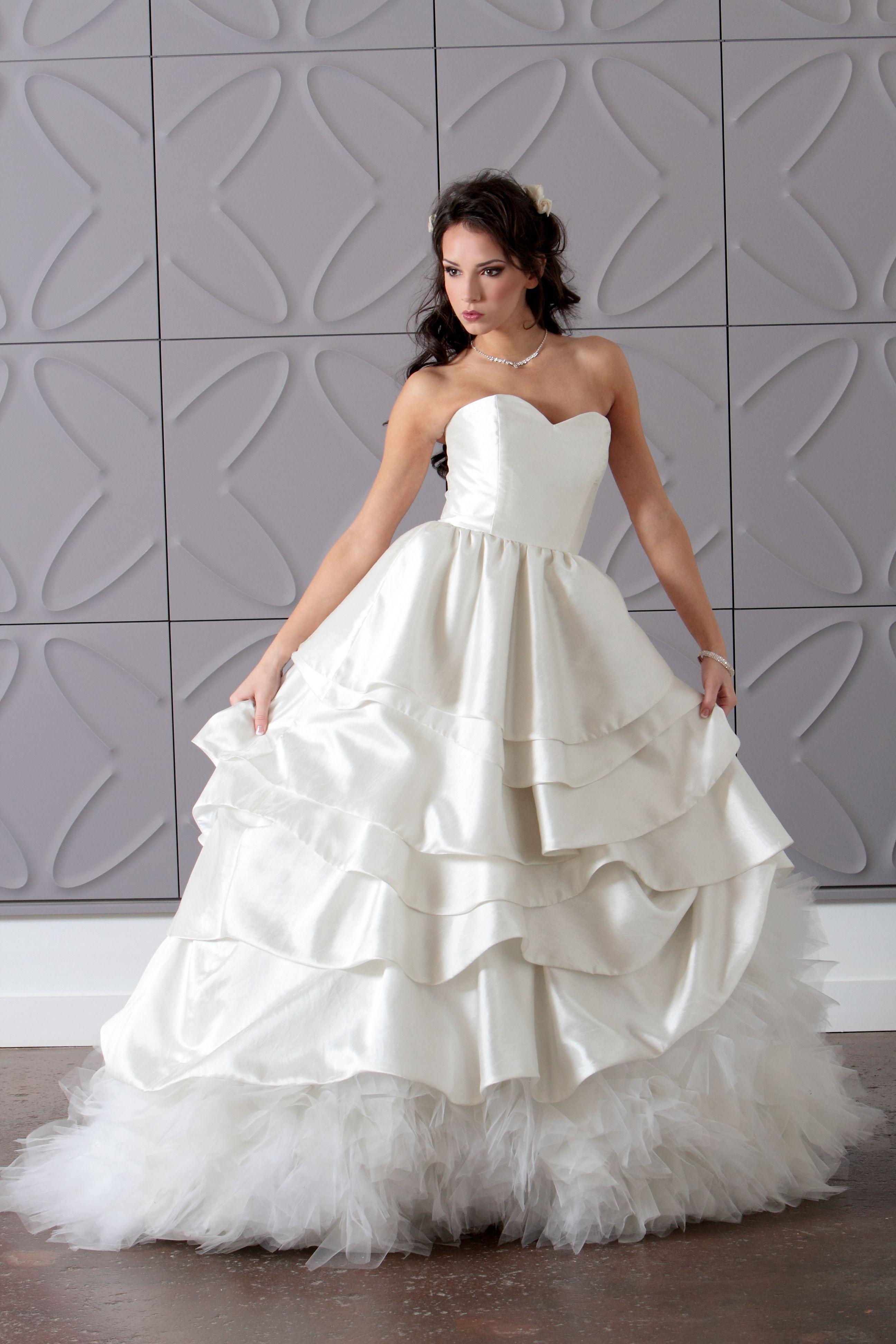 A detachable bridal gown each layer is detachable
