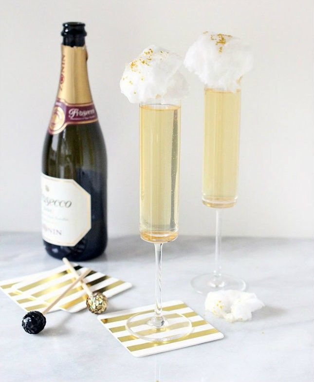 Bridal shower cocktail idea - ginger + Prosecco cocktail with cotton candy topper {Courtesy of Brit + Co}