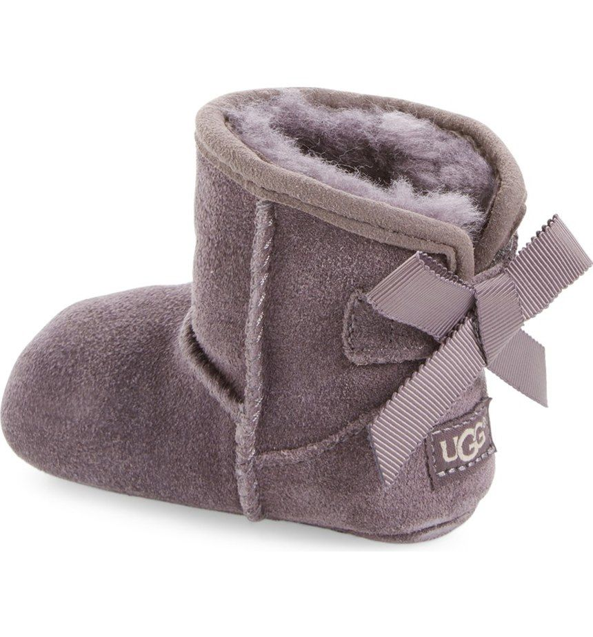 Adoring these soft and cozy UGG Australia boots with a darling bow in the back.