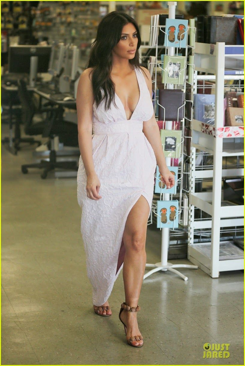 Pink cut out dress kim kardashian  Kim Kardashian shooting scenes for her hit show Keeping Up with the