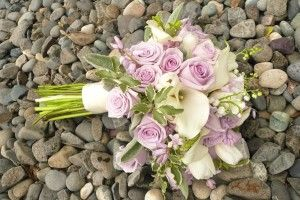 Classic 'ocean song' roses, calla lilies, and lily of the valley are pared with soft and luscious lambs ear...created by Julie Meyer-Flowers Washougal