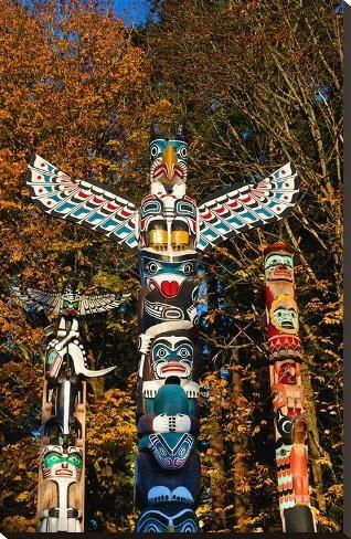 size: 37x24in Stretched Canvas Print: Totems Stanley Park Vancouver : Using advanced technology, we print the image directly onto canvas, stretch it onto support bars, and finish it with hand-painted edges and a protective coating.