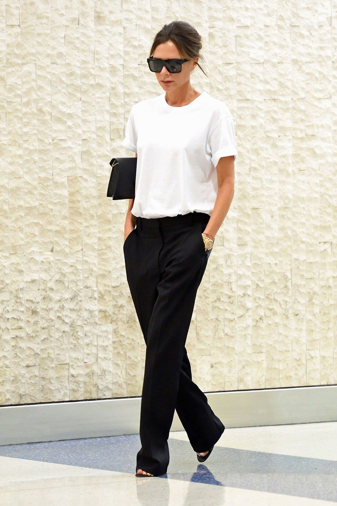 3be7615cc68d Victoria Beckham's Airport Style Ahead of Her Spring 2018 Show in ...