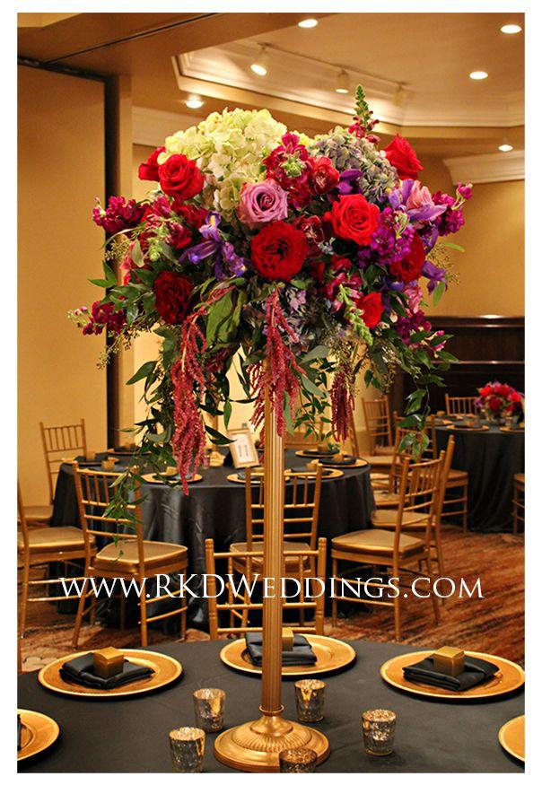 Lush arrangement of stock, roses, hydrangea, hanging amaranthus and foliage