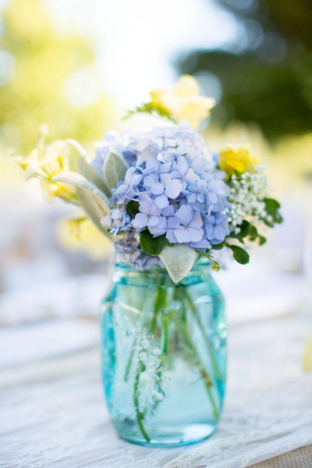 Mason Jars Tinted Blue With Pretty Yellow And Flowers In
