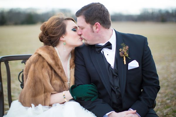 a bride in a fur stole for a winter wedding (faux fur, of course)