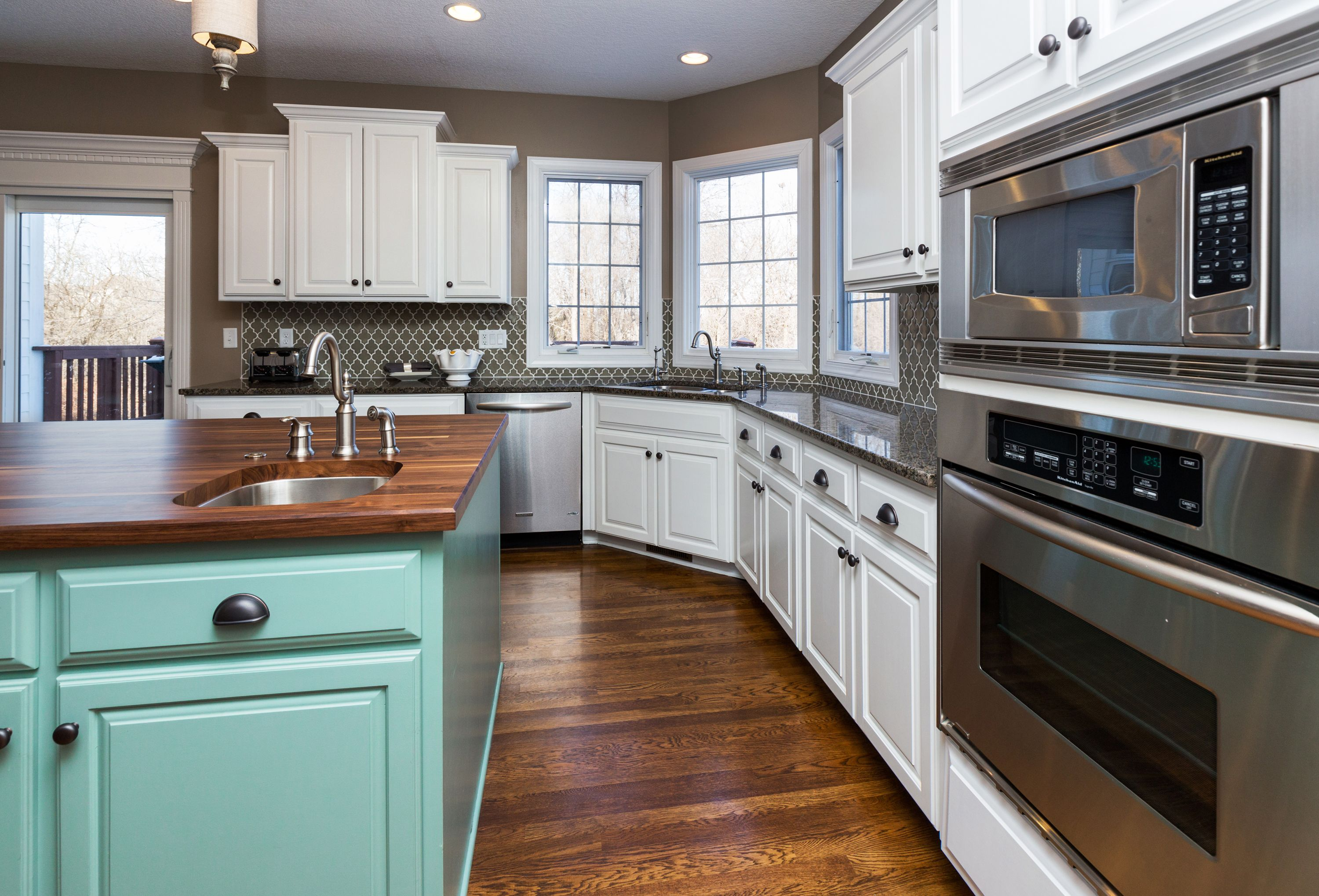 The Blue Island With Butcher Block Top Is A Focal Point In This Neutral Kitchen Home Remodeling Neutral Kitchen Home