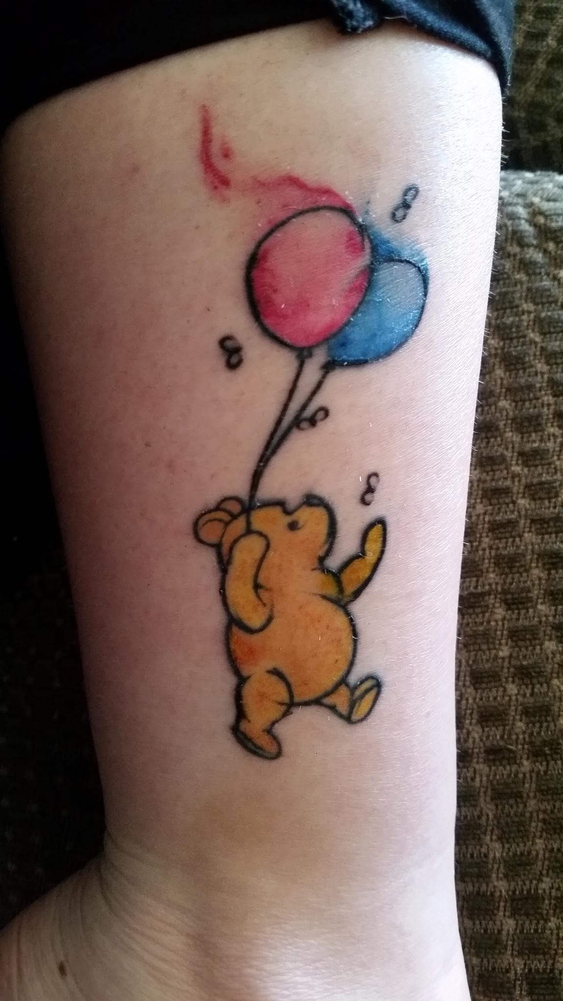My first tattoo old school Winnie the Pooh. First