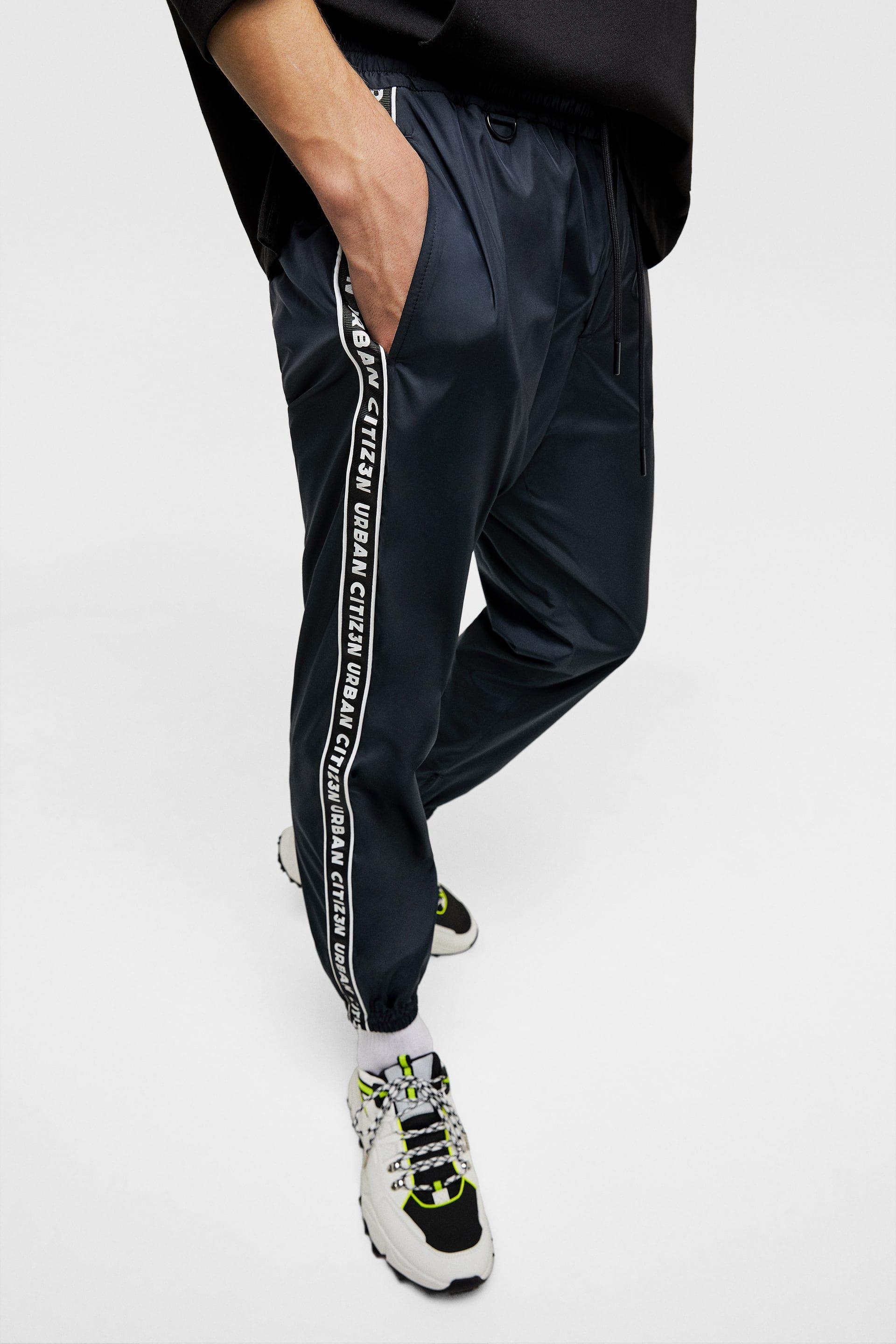 fc89451d2a Technical trousers with slogan-printed taping in 2019 | Men - BLUE ...
